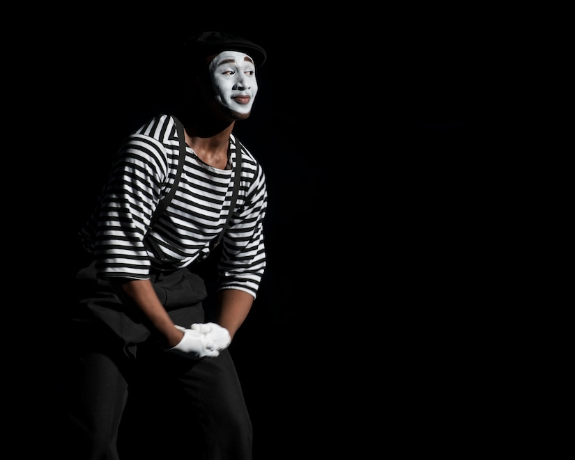Airman 1st Class Jonathan Leak performs as a mime at the Tops in Blue show Jan. 9, 2013, at the North Charleston Performing Arts Center, S.C. Composed of 35 to 40 vocalists, musicians, dancers and technicians , the group's primary mission is to perform for military personnel and their families around the world. This year's tour took Tops in Blue throughout the United States and to more than 20 countries with approximately 130 performances during a 10-month period. (U.S. Air Force photo/Airman 1st Class Ashlee Galloway)