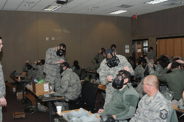 SIOUX FALLS, S.D. -- Members of the South Dakota Air National Guard helped wingmen adjust their new gas masks to attain a proper seal during training for their new M-50 Joint Services General Purpose Gas Mask January 6th 2013.(National Guard photo by Master Sgt. Christopher Stewart)(Released)