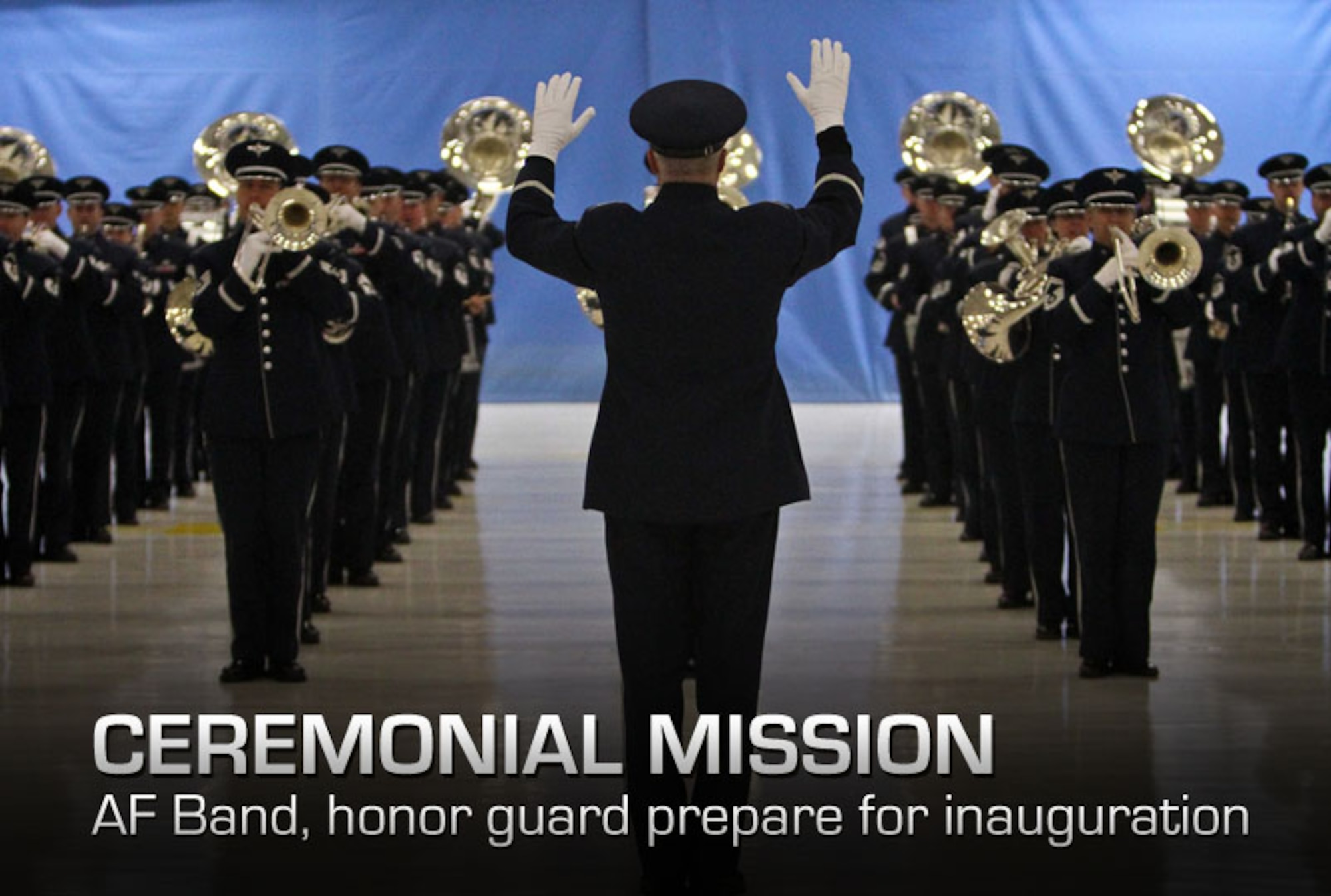 Col. Larry H. Lang conducts during a dress rehearsal for the Inaugural Parade at Joint Base Andrews, Md., Jan. 11, 2013. Colonel Lang is the commander of the U.S. Air Force Band. (DOD photo/Claudette Roulo)
