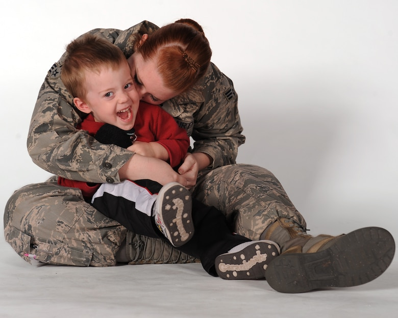 U.S. Air Force Senior Airman Brittany Dowdle, 355th Fighter Wing Public Affairs photojournalist, hugs her son, Easton, on Davis-Monthan Air Force Base, Ariz., Jan. 10, 2013. As a single parent in the military, Dowdle faces unique challenges when it comes to taking care of her son. (U.S. Air Forcephoto by Senior Airman Timothy Moore/Released)