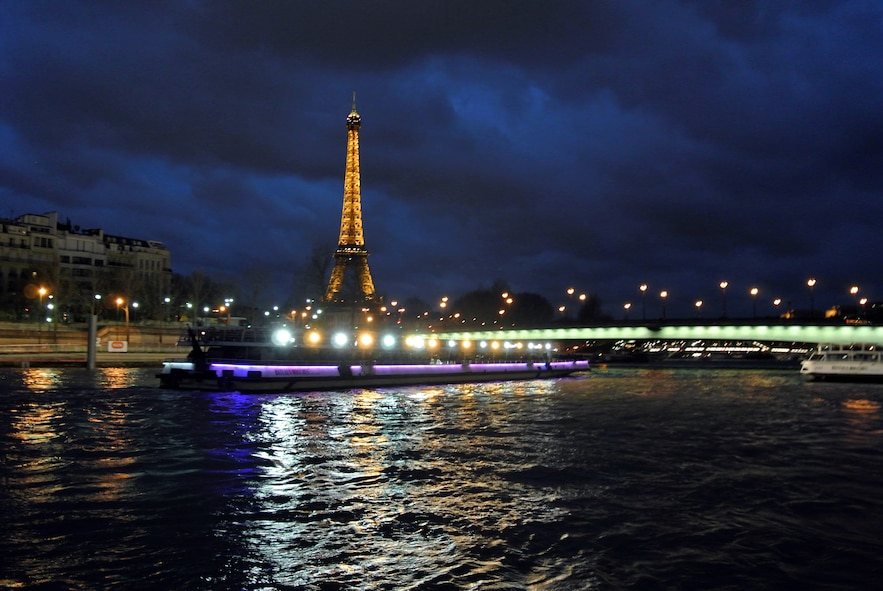 The Eiffel tower illuminates the skyline during a boat tour of the City of Light. The Eiffel tower was constructed in 1889 and is one of the most recognized and photographed structures in the world. (U.S. Air Force photo/Senior Airman Michael Battles)
