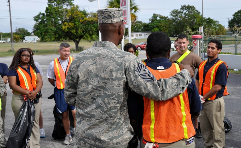 Airmen and servicemembers from Homestead Air Reserve Base, Fla., along with students of Homestead Job Corps, cleaned up roadside trash along 10 blocks of South West 288th St. in support of Adopt-A-Highway in Homestead, Fla., recently. The base has partnered with Job Corps on multiple occasions to provide outreach to the area. (U.S. Air Force photo/Senior Airman Jacob Jimenez)
