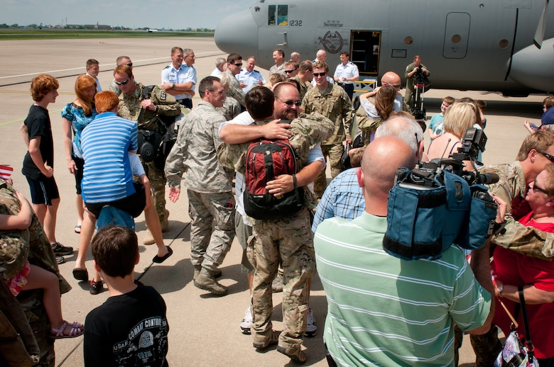 Friends and family members welcome home a dozen members of the 123rd Special Tactics Squadron on the flight line of the Kentucky Air National Guard Base in Louisville, Ky., May 5, 2012. The Airmen spent six months in Afghanistan in support of Operation Enduring Freedom. (U.S. Air Force photo by Senior Airman Maxwell Rechel)