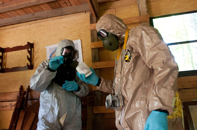Members of the Kentucky National Guard's 41st Civil Support Team survey a cabin where suspected bomb making substances are present during a U.S. Army North exercise on Oct. 2, 2012, in Frankfort, Ky. (Kentucky Air National Guard photo by Master Sgt. Phil Speck)