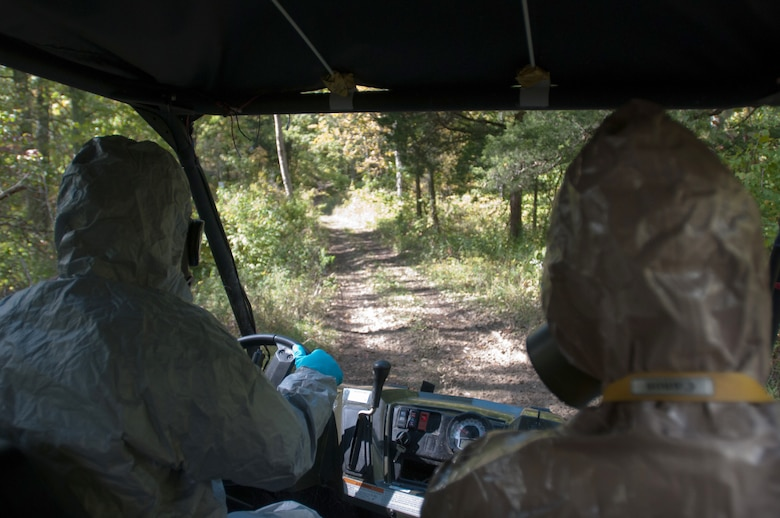 Members of the Kentucky National Guard's 41st Civil Support Team drive through the woods to a cabin where suspected bomb making substances are present during a U.S. Army North exercise on Oct. 2, 2012, in Frankfort, Ky. (Kentucky Air National Guard photo by Master Sgt. Phil Speck)