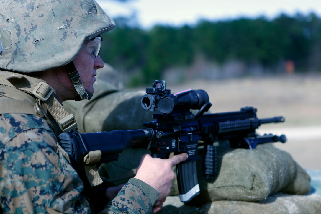A student with Company D, Infantry Training Battalion – East looks down range after firing the M27 Infantry Automatic Weapon aboard Marine Corps Base Camp Lejeune Jan. 9. The IAR is meant to replace the M249 Squad Automatic Weapon, giving Marines a lighter, more precise weapon to use while deployed.
