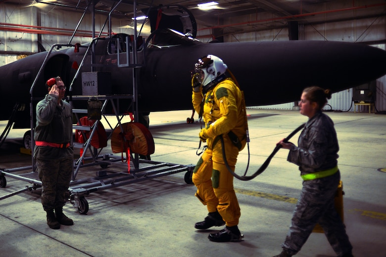 "A maintainer from the 9th Aircraft Maintenance Squadron salutes U-2 pilot Capt. Travis as he prepares for a ""high flight"" in the U-2 Dragon Lady Jan. 8, 2013, at Beale Air Force Base, Calif. (U.S. Air Force photo by Airman 1st Class Drew Buchanan/Released)"
