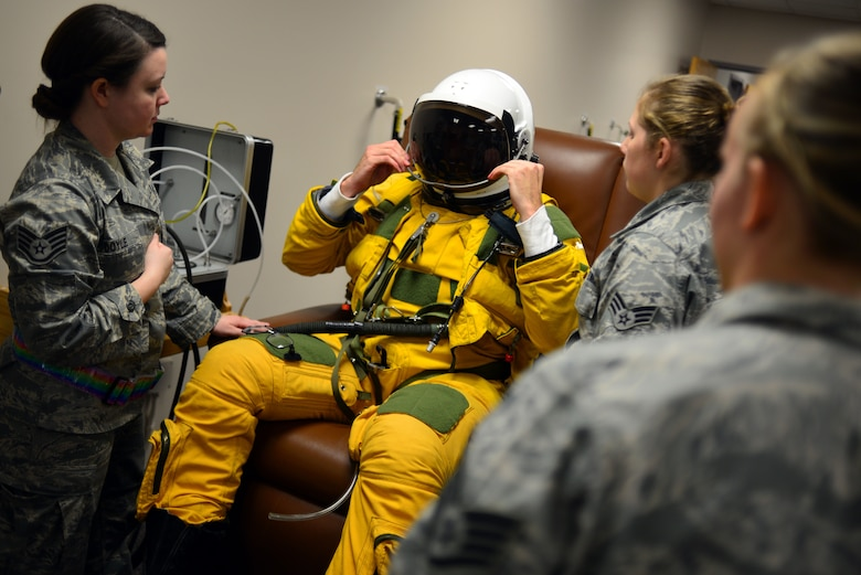 "U-2 pilot Capt. Travis dawns the sun visor on his pressure suit helmet during pre-flight suit dawning in preparation for a ""high flight"" in the U-2 Dragon Lady Jan. 8, 2013, at Beale Air Force Base, Calif. The full pressure suit, developed by the U.S. Air Force has been adopted by NASA and other agencies for use by astronauts and other high altitude crews. (U.S. Air Force photo by Airman 1st Class Drew Buchanan/Released)"