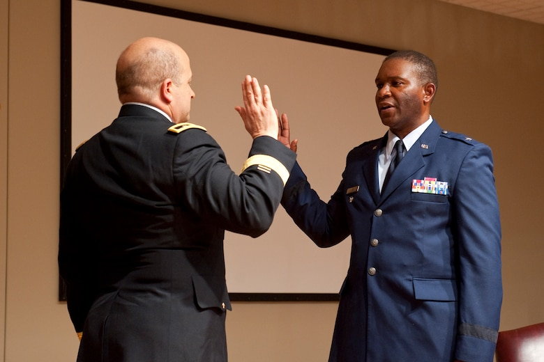 South Carolina Adjutant General, Maj. Gen. Robert E. Livingston, Jr., administers the oath of office to newly promoted Brig. Gen. Calvin H. Elam, at a ceremony at McEntire Joint National Guard Base on January 13, 2013. Elam becomes the South Carolina Air National Guard's first black general officer. Elam has served as the Assistant Adjutant General for Air for the South Carolina National Guard since January 2012. As a civilian, he is Chief Executive Officer for Elam Financial Group. (National Guard photo by Staff Sgt. Jorge Intriago/Released)