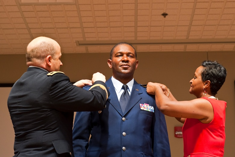 South Carolina Adjutant General, Maj. Gen. Robert E. Livingston, Jr. and Mrs. Mary Elam, pin newly promoted Brig. Gen. Calvin H. Elam, at a ceremony at McEntire Joint National Guard Base on January 13, 2013. Elam becomes the South Carolina Air National Guard's first black general officer. Elam has served as the Assistant Adjutant General for Air for the South Carolina National Guard since January 2012. As a civilian, he is Chief Executive Officer for Elam Financial Group. (National Guard photo by Staff Sgt. Jorge Intriago/Released)