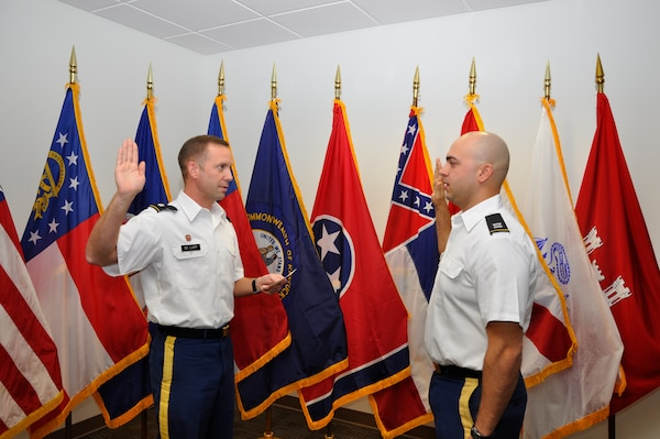 Lt. Col. James A. DeLapp, left, U.S. Army Corps of Engineers Nashville District commander, administers the Oath of Office to newly promoted Capt. Corey. T. Wolff Dec. 7, 2012. A native of Chatham, Ohio, Wolff is a 2009 West Point graduate, combat veteran of Afghanistan, and presently serves as project officer and quality assurance representative on the Cheatham Lock and Resource Management buildings contract in Ashland City, Tenn.