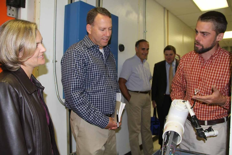 ERDC Cold Regions Research and Engineering Geophysicist Dr. Christopher Polashenski briefs Navy Task Force Climate Change Arctic Affairs Officer Cmdr. Angela Walker and Deputy Director Joseph Brenner.
