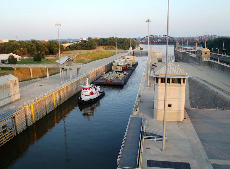 A tugboat, the M/V Mr. Russell, pulls a barge through the chamber at McAlpine Locks and Dam on the Ohio River at Louisville, Ky.