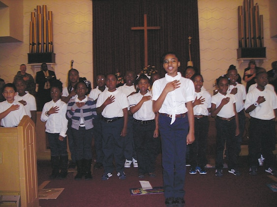 Students with the International Studies Elementary Charter School lead the Pledge of Allegiance during Marine Corps Logistics Base Albany's 2013 Dr. Martin Luther King Jr. observance.