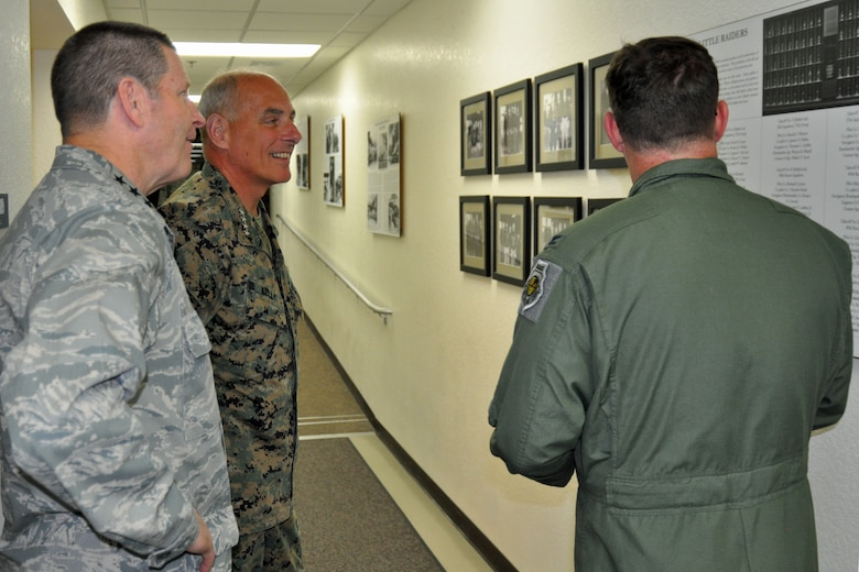 Marine Gen. John F. Kelly, U.S. Southern Command commander, discusses the history and lineage of the 612th Air and Space Operations Center with Lt. Gen. Robin Rand, 12th Air Force (Air Forces Southern) commander, and Col. James Bortree, 612th AOC commander, at Davis-Monthan Air Force Base, Jan. 14. Kelly, who assumed his current role Nov. 19, was on his first visit to 12th AF (AFSOUTH) which serves as the air arm of USSOUTHCOM. (U.S. Air Force photo by Capt. Justin Brockhoff / Released)