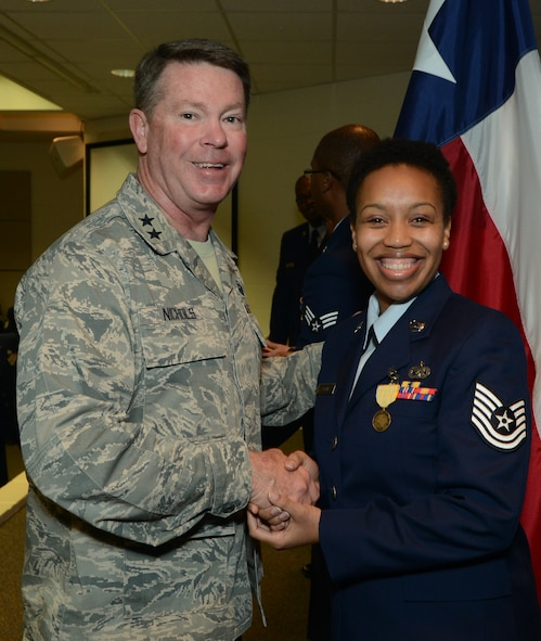 Major Gen. John Nichols, Adjutant General for the State of Texas congratulates Tech. Sgt. Carolyn Tatum, 136th Air Lift Wing, Non Commissioned Officer of the Year for Texas, at Camp Mabry, Jan.13, 2013. Tatum continues on for the State in the national competition, competing against active duty Air Force and Reserves. (National Guard photo by Senior Master Sgt. Elizabeth Gilbert)
