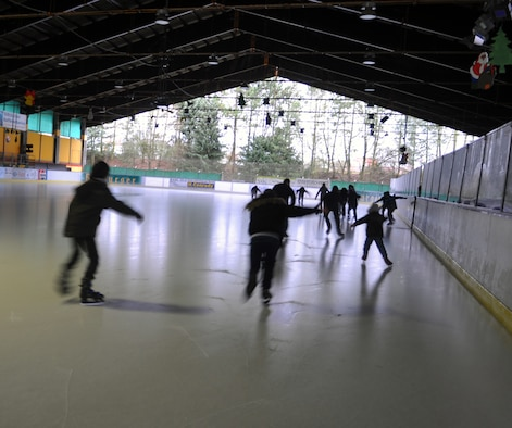 BITBURG, Germany - A large number of visitors, including school students and many families with small children, enjoy skating at the Bitburg ice rink throughout the winter months. The Bitburg rink was opened to the public in 1982. The rink is now open for the 2013 season and will remain open until April when the facility is converted into a summer fun park. (U.S. Air Force photo by Iris Reiff)