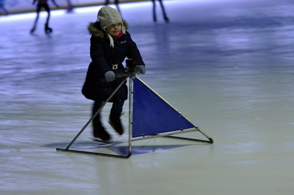 BITBURG, Germany - A young girl glides over the ice with a children's learning stool. The Bitburg ice rink provides various equipment to help children learn to skate.  (U.S. Air Force photo by Iris Reiff/Released)