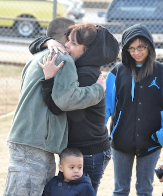 Airman 1st Class Jesus Lerma, 507th Aircraft Maintenance Squadron, hugs his mother before processing the deployment line here Jan. 5. Lerma is one of 130 reserve Airmen who deployed to Southwest Asia in support of operations in the U.S. Central Command area of responsibility early this month. (U.S. Air Force photo by Senior Airman Mark Hybers)