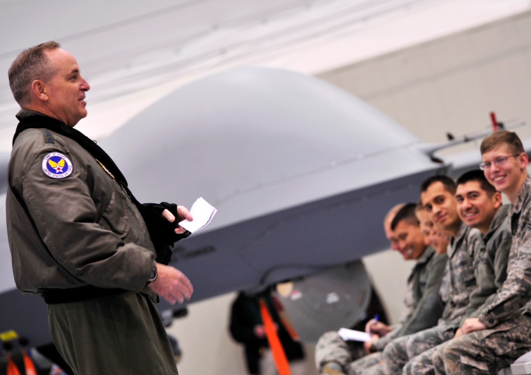 """CREECH AIR FORCE BASE, Nev. -- Air Force Chief of Staff Gen. Mark A. Welsh III speaks to Airmen during an all call, Jan. 14, 2013. Welsh commended the Creech Airmen during an all call for their adaptability and ability to overcome obstacles and fulfill their motto: """"Hunters save lives."""" (432d Wing/432d Air Expeditionary Wing Public Affairs)"""
