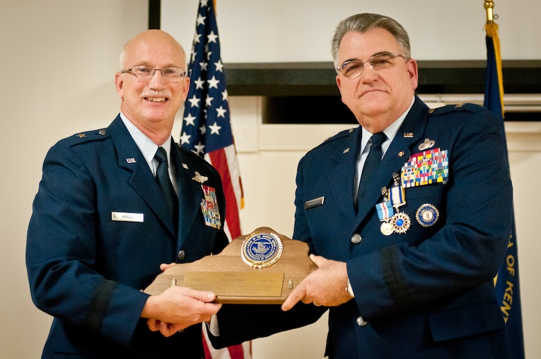 Brig. Gen. Michael Dornbush (right), the outgoing director of Joint Staff at Joint Forces Headquarters-Kentucky, receives a plaque in recognition of 40 years of service from Brig. Gen. Mark Kraus, Kentucky's assistant adjutant general for Air, during a retirement ceremony at the Kentucky Air National Guard Base in Louisville, Ky., on Jan. 12, 2013. Dornbush has served as a flight and squadron commander, a vice wing commander and a deployed group commander in support of Operation Enduring Freedom. (U.S. Air Force photo by Staff Sgt. Maxwell Rechel)
