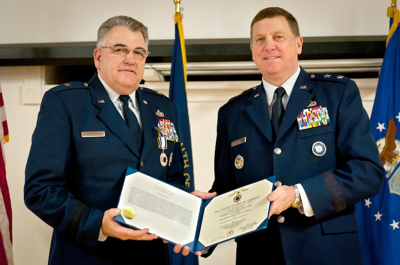Brig. Gen. Michael Dornbush (left), the outgoing director of Joint Staff at Joint Forces Headquarters-Kentucky, receives the Distinguished Service Medal from Maj. Gen. Edward W. Tonini, Kentucky's adjutant general, during a retirement ceremony at the Kentucky Air National Guard Base in Louisville, Ky., on Jan. 12, 2013. Dornbush served in the Air Force and Kentucky Air National Guard for more than 40 years. (U.S. Air Force photo by Staff Sgt. Maxwell Rechel)