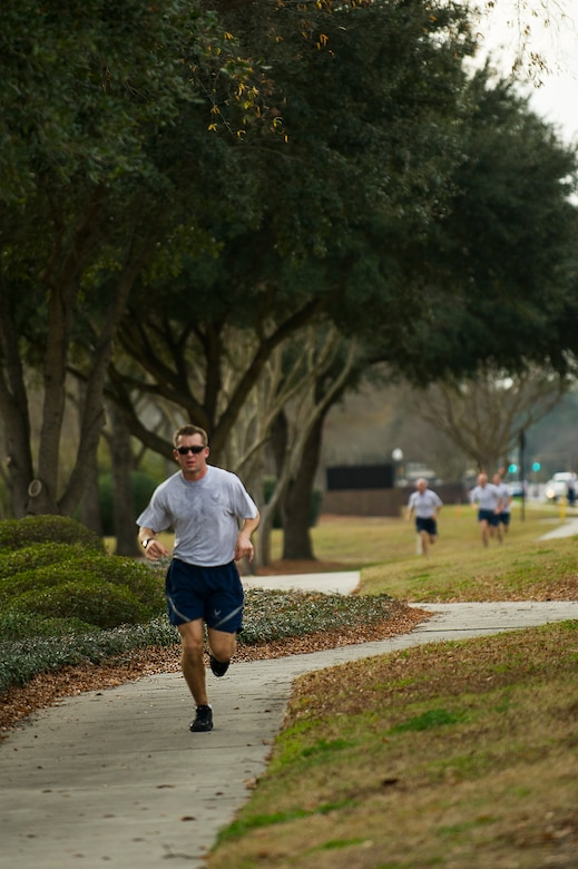 Capt. Austin McCann, 15th Airlift Squadron pilot, approaches the finish line during the Martin Luther King Jr. Day 5k Run Jan. 11, 2013, at Joint Base Charleston, S.C. McCann finished as the top male in the race with a time of 18:37 . The 5k was a tribute to Martin Luther King Jr., and served as a reminder of his accomplishments and sacrifices. (U.S. Air Force photo/Senior Airman George Goslin)