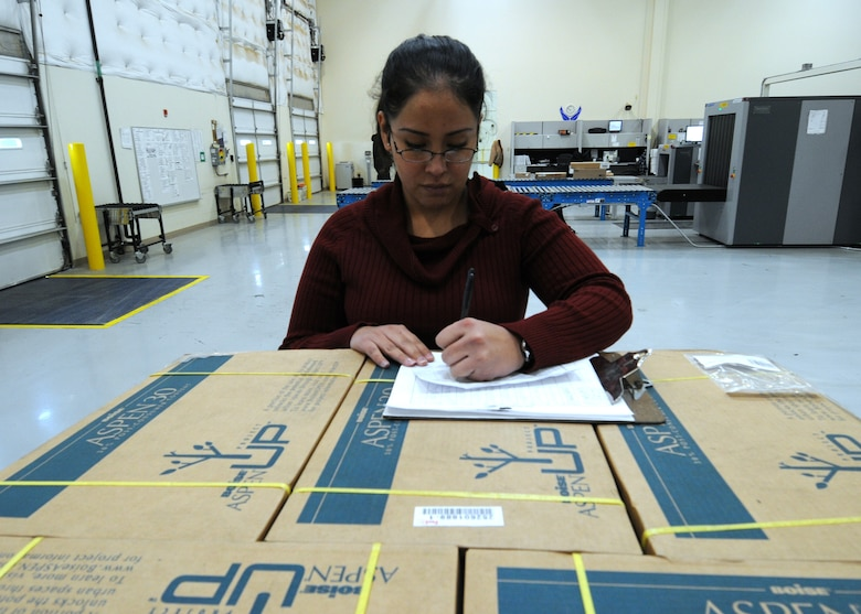 Rocio Oquendo, 50th Logistics Readiness Flight, inventories packages and cargos Jan. 15 at the flight's Secure Area Logistics Facility. The 50 LRF's mission is to conduct deployment planning, training and execution; base support planning, and logistics command and control in support of the Aerospace Expeditionary Force and Global Force Management construct. The flight performs logistics planning; manages the wing support agreements, mobility bags, deployment small-arms weapons, ammunition and transportation programs. (U.S. Air Force photo/Staff Sgt. Julius Delos Reyes)