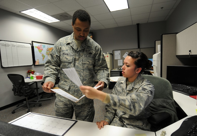 Staff Sgt. Dionisio Bowen, 50th Logistics Readiness Flight logistics planner, and Senior Airman Ashley Mondragon, 50th Force Support Squadron installation personnel readiness journeyman, discuss personnel deployment records Jan. 15 at the installation deployment readiness cell. The 50 LRF's mission is to conduct deployment planning, training and execution; base support planning, and logistics command and control in support of the Aerospace Expeditionary Force and Global Force Management construct. The flight performs logistics planning; manages the wing support agreements, mobility bags, deployment small-arms weapons, ammunition and transportation programs. (U.S. Air Force photo/Staff Sgt. Julius Delos Reyes)