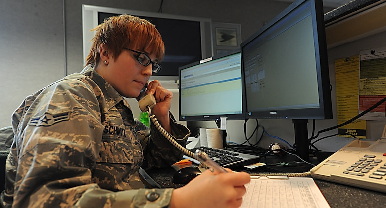 WHITEMAN AIR FORCE BASE, Mo. -- Airman 1st Class Hannah Schmitz, 509th Operations Support Squadron airfield management coordinator, receives a call from a supervisor informing her of a possible Bird Aircraft Strike Hazard, Jan. 9. Airfield management coordinators at Whiteman AFB keep the bird watch conditions updated and disperse about 50-100 species of birds. (U.S. Air Force photo/Staff Sgt. Nick Wilson) (Released)