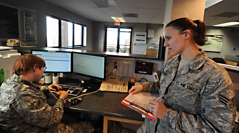 WHITEMAN AIR FORCE BASE, Mo. -- Airman 1st Class Hannah Schmitz, 509th Operations Support Squadron airfield management coordinator, and Senior Airman Alessandra Aceves-Harnden, 509th OSS airfield management coordinator, receive notification of a possible Bird Aircraft Strike Hazard, Jan. 9. Airfield management coordinators are responsible for updating bird-watch conditions, which let pilots and air-traffic controllers know what BASH threat level they can expect on flying days. (U.S. Air Force photo/Staff Sgt. Nick Wilson) (Released)