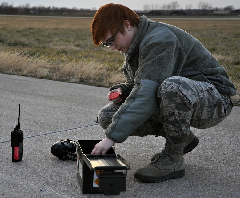 WHITEMAN AIR FORCE BASE, Mo. – Airman 1st Class Hannah Schmitz, 509th Operations Support Squadron airfield management coordinator, prepares pyrotechnics while responding to a bird threat, Jan. 9. Pyrotechnics and other resources help keep birds away from the paths of departing, landing and flying aircraft. (U.S. Air Force photo/Senior Airman Wesley Wright)