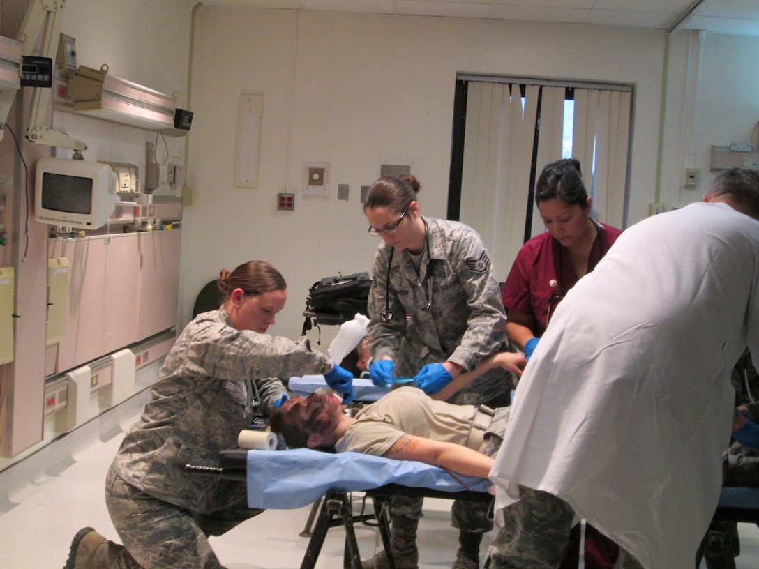 Master Sgt. Erica Jasper (left), Staff Sgt. Caitlyn Thomason and Maj. Marlo Repeta provide care for a simulated trauma victim during a training held at Joint Base Andrews January 10, 2013. The training is to ensure the team is ready to be a part of the 57th Presidential Inauguration as a medical response unit. The team is from the 79th Medical Wing. Jasper is and emergent care clinic medical technician, Thomason is a medical technician and Repeta is a nurse. (U.S. Air Force Photo/Melanie Moore)