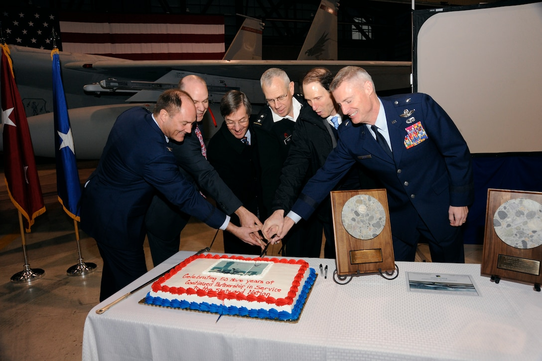 Leadership from the Oregon National Guard and Port of Portland cut a ceremonial cake as part of the announcement of the 50-year lease agreement with the Port of Portland, during a ceremony at the Portland Air National Guard Base in Portland, Ore., Jan. 16.  The agreement allows the Oregon Air National Guard's 142nd Fighter Wing to continue operations at the Portland International Airport. (Photo by Tech. Sgt. John Hughel, 142nd Fighter Wing Public Affairs/Released)