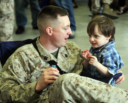 Staff Sgt. Phillip Dixon, Marine Aviation Logistics Squadron 31 avionics test set technician, spends quality time with his son PJ Dixon, 3, before deploying to Afghanistan Jan. 11. MALS-31 is augmenting MALS-40 in Helmand Province, Afghanistan in support of Operation Enduring Freedom.