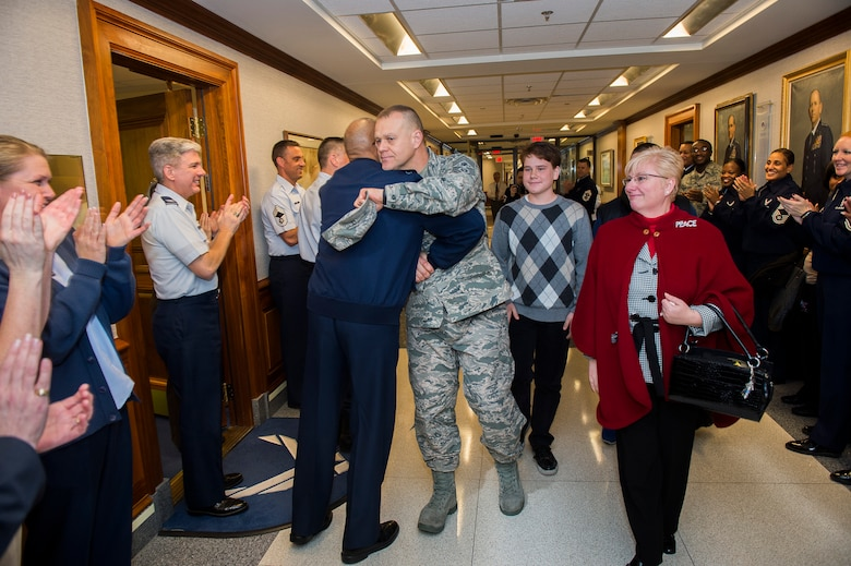 Chief Master Sgt. of the Air Force James Roy hugs Air Force Vice Chief of Staff Gen. Larry Spencer, while Roy and his family depart the Pentagon, Jan. 17. 2013, on his last day in the office prior to his retirement and transition ceremony on Jan. 24.  Roy is the 16th chief master sergeant of the Air Force. (U.S. Air Force photo/Jim Varhegyi)