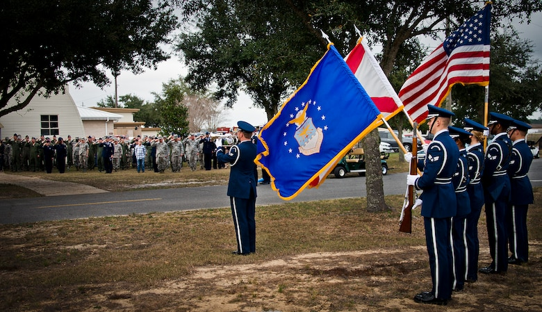 Members of the 919th Special Operations Wing salute their lost Airman during the playing of Taps by Senior Airman Anthony Holochwost, of the Eglin Honor Guard, during the Senior Airman Josh Santos memorial Jan. 13 at Duke Field.  Santos passed away Nov. 26 from colon cancer.  He was a radio operator with the 711th Special Operations Squadron.  During the memorial, it was announced the Duke Field gym would be renamed Santos Strength in his honor.  (U.S. Air Force photo/Tech. Sgt. Samuel King Jr.)