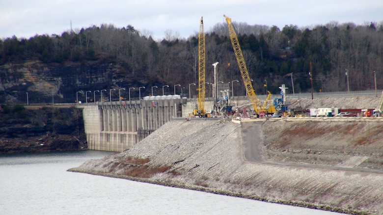 Construction crews work to install a concrete barrier wall Jan. 11, 2013 into the embankment at Wolf Creek Dam in Jamestown, Ky. The U.S. Army Corps of Engineers Nashville District is ahead of schedule on the Wolf Creek Dam Foundation Remediation Project and is now making plans to raise the water level at Lake Cumberland this summer. The barrier wall is currently on track to be completed by the early spring of 2013, which is significantly ahead of the previously planned completion date in December 2013. (USACE photo by Lee Roberts)