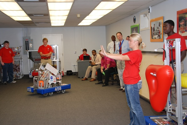 Robotics Student Kelsey McMaster gives Vicksburg-Warren School District administrators a demonstration of the team's robot in the ERDC Science, Technology, Engineering, and Mathematics Center.