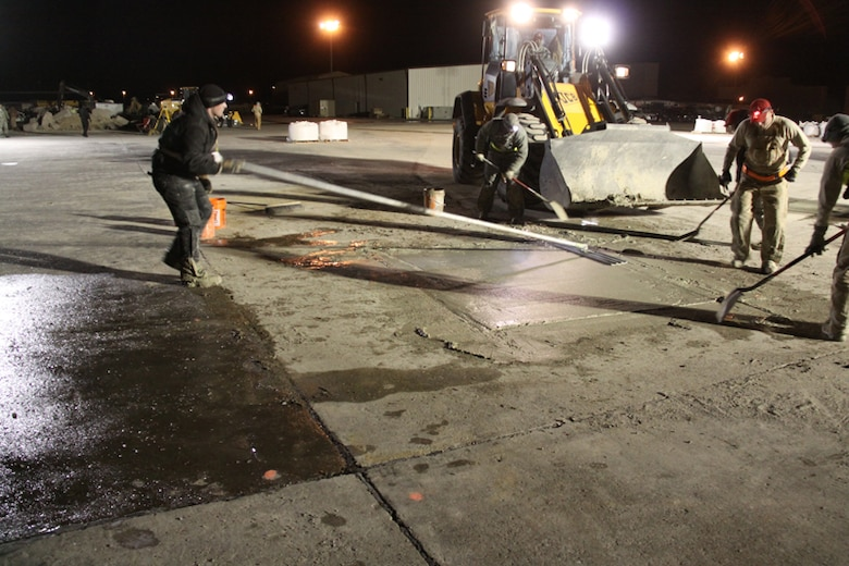 Another look at RED HORSE practicing screeding in preparation for cold weather demo at Malmstrom.