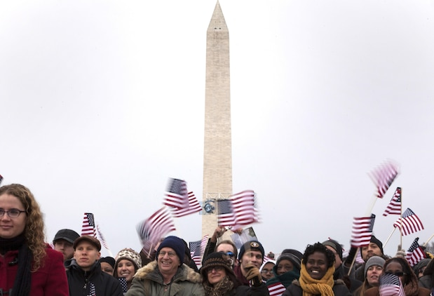 Audience members gather in front of the Washington Memorial on the National Mall in Washington during the 57th Presidential Inauguration Jan. 21, 2013. More than 700 thousand people made their way to the National Mall for the day's events. For centuries, Marines and other service members have supported the inaugural events. This year, more than 180 Marines from Marine Barracks Washington marched in the Inaugural Parade behind The President's Own band.