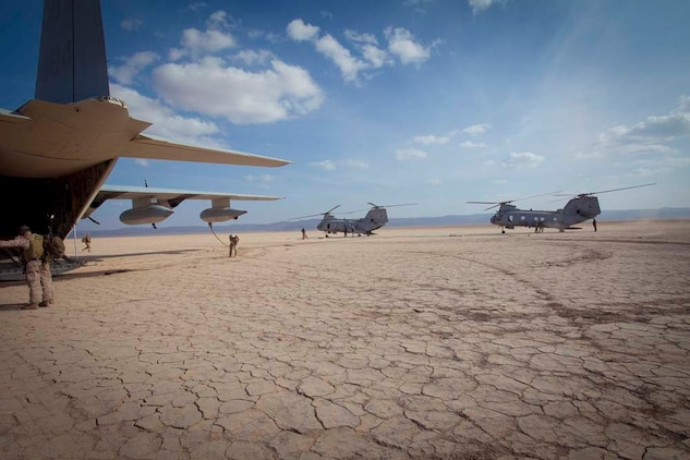 """Two CH-46E Sea Stallions with Marine Medium Helicopter 364 (Rein.), 15th Marine Expeditionary Unit, land to refuel during a Mobile Marine Air Traffic Control training evolution in Djibouti, Jan 4.   The mission for the MMT, or """"pathfinders"""" as they're colloquially referred to, is to establish an assault landing zone (runway) and provide air traffic control for multiple aircraft as well as command and control during the entire refuel/resupply mission.  The 15th MEU is deployed as part of the Peleliu Amphibious Ready Group as a U.S. Central Command theater reserve force, providing support for maritime security operations and theater security cooperation efforts in the U.S. 5th Fleet area of responsibility.  (U.S. Marine Corps photo by Gunnery Sgt. Jennifer Antoine)"""