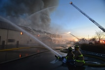 Firefighters work to extinguish a blaze at the Civil Engineer Squadron building Jan. 21, 2013, at Beale Air Force Base, Calif. (U.S. Air Force photo by Airman 1st Class Drew Buchanan/Released)