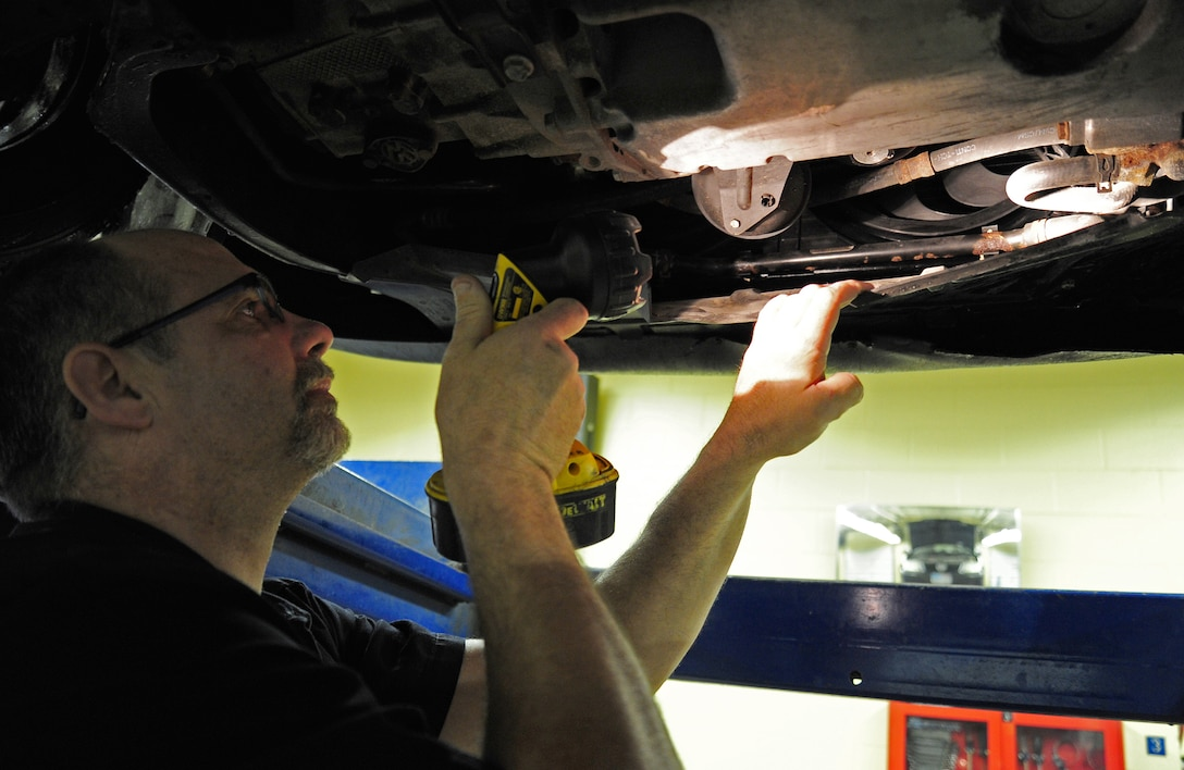 Kirk Sadowski , a mechanic with the 92nd Force Support Squadron, searches for a leak on a car at the auto hobby shop at Fairchild Air Force Base, Wash., Jan. 18, 2013. Having a leak on a vehicle can cause severe damage if not taken care of right away. (U.S. Air Force photo by Airman 1st Class Janelle Patiño)