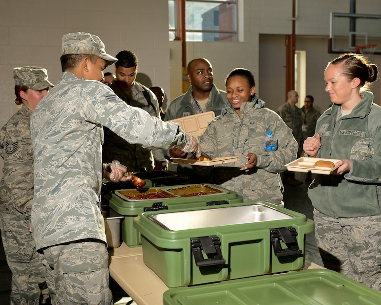 Air National Guardsmen from the Joint STARS 116th Force Support Squadron (FSS), Robins Air Force Base, Ga., serve a hot meal to members of the 113th Fighter Wing, Joint Base Andrews, Md., at the Kennedy Recreation Center in Washington, D.C., Jan. 20, 2013.  The nine person team from Georgia deployed to the National Capital Region joining more than 6,000 Guardsmen from 32 states and territories as part of the Joint Task Force-District of Columbia.  Living and working in field conditions, the primary mission of the 116th FSS was to provide meals from their mobile field kitchen to troops supporting the events surrounding the inauguration.  A secondary mission included being sworn in as Special Police to assist the District of Columbia Police Department as needed. (National Guard photo by Master Sgt. Roger Parsons/Released)