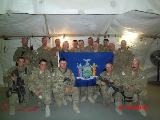 Members of the 174th Attack Wing Security Forces Squadron, New York Air National Guard, pose for a group photo while deployed to Bagram Air Base, Afghanistan in late 2012. A total of 30 personnel deployed from Hancock Field Air National Guard Base, Syracuse, New York and provided an array of security functions both inside and outside the wire. This was the fourth overseas deployment for the SFS since 2005. (Photo by New York Air National Guard Staff Sgt. Ronald Atwood/Released)