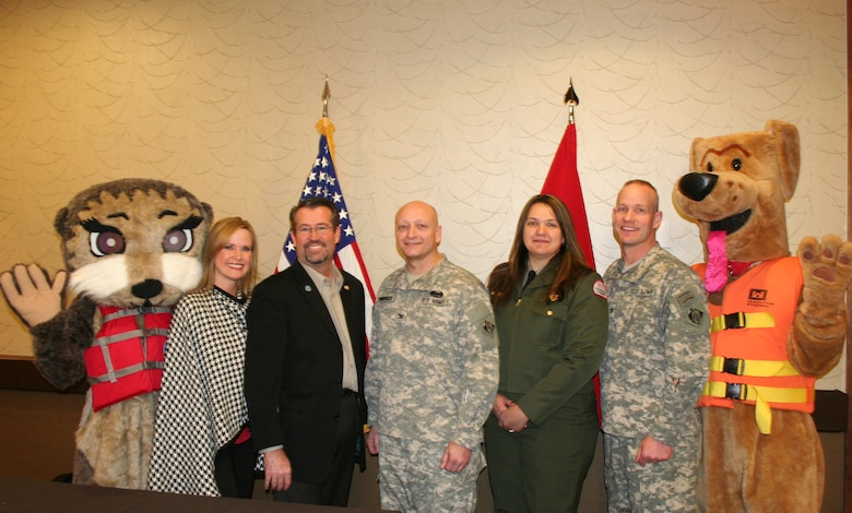 Today, at a District employee forum, Omaha District Commander, Col. Joel R. Cross, along with Northwestern Division Commander Anthony C. Funkhouser formally recognized the memorandum of understanding recently signed by the Corps, formalizing a partnership agreement with the Joshua Collingsworth Memorial Foundation. Left to Right are Josh the Otter, Kathy Collingsworth, Blake Collingsworth, Col. Anthony C. Funkhouser, Jolene Hulsing, Col. Joel R. Cross, Bobber the Water Safety Dog.