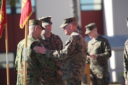 MARINE CORPS CAMP PENDLETON, Calif. – (Right) Maj. Gen. Melvin G. Spiese, deputy commanding general of I Marine Expeditionary Force and (Center) Col. Christopher D. Taylor, commanding officer of 13th Marine Expeditionary Unit, welcome Col. Matsushi Kunii after the Exercise Iron Fist 2013 opening ceremony, aboard Marine Corps Base Camp Pendleton. During Iron Fist 2013, the 13th MEU and Western Army Infantry Regiment, JGSDF will spend three weeks participating in bilateral training to improve their interoperability, enhance military-to-military relations and sharpen skills essential to crisis response.