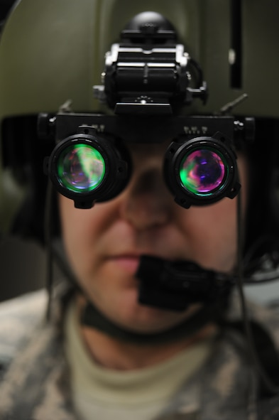 WHITEMAN AIR FORCE BASE, Mo. -- Chief Warrant Officer 2 Thomas Bottini, 1-135th Attack Reconnaissance Battalion AH 64D Apache Longbow pilot, performs operations checks on night-vision goggles, Jan. 16. Night vision goggles aid pilots with nighttime flying and navigation by intensifying ambient light. (U.S. Air Force photo/Staff Sgt. Nick Wilson) (Released)