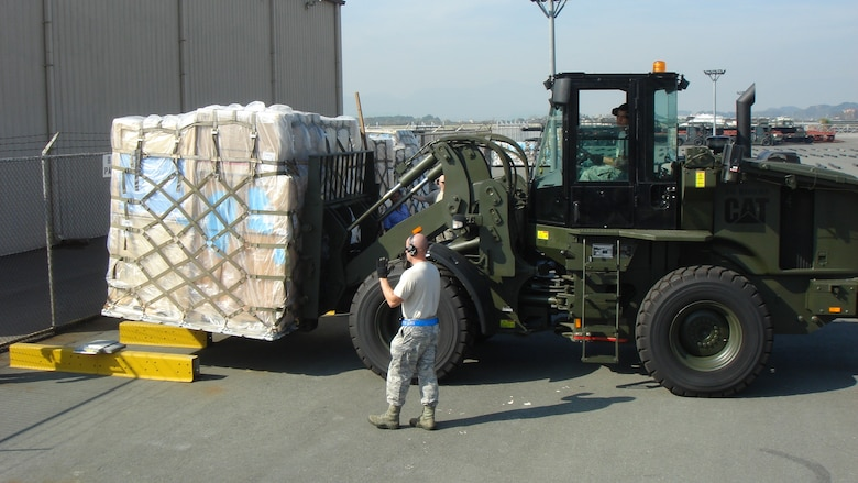 Airmen with the 731st Air Mobility Squadron move a palette to be loaded on an aircraft at Osan Air Base, Republic of Korea. The squadron ensures air cargo and passengers for United States Forces members in Korea are safely transported without interruption. (courtesy photo)